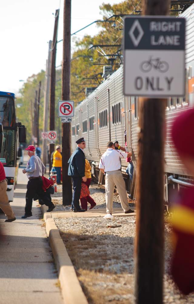 Visitors stepping out of trains and onto buses in South Bend