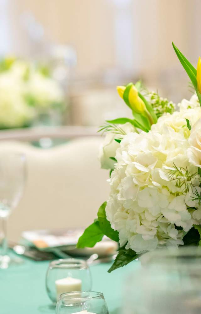 A close up photo of a flower arrangement at the Gillespie Conference Center