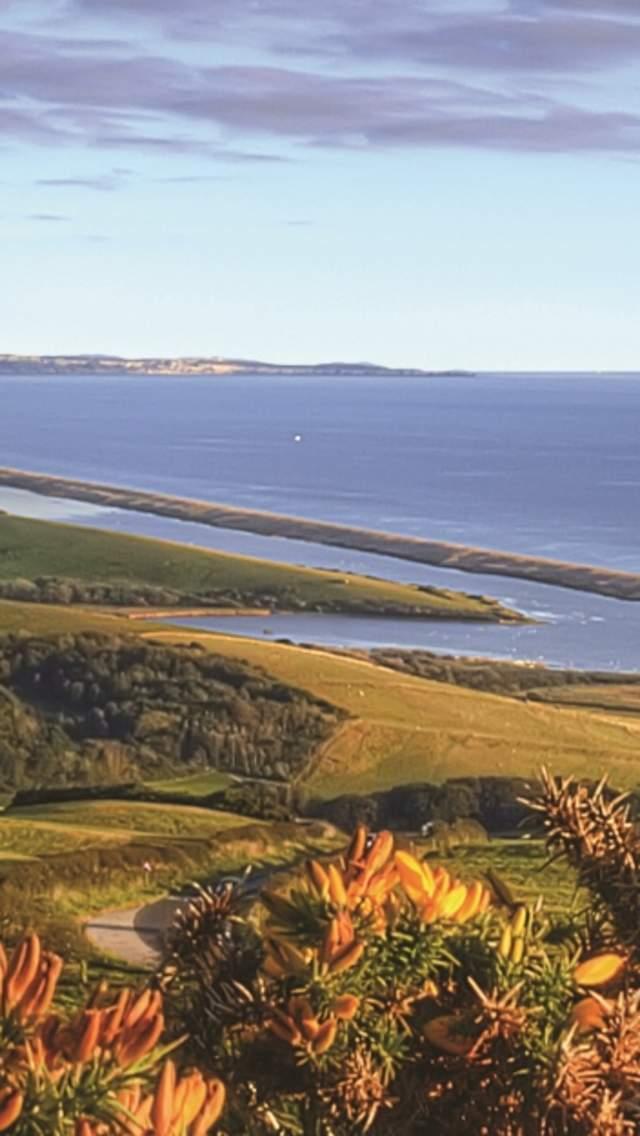 View over Abbotsbury to Chesil Beach