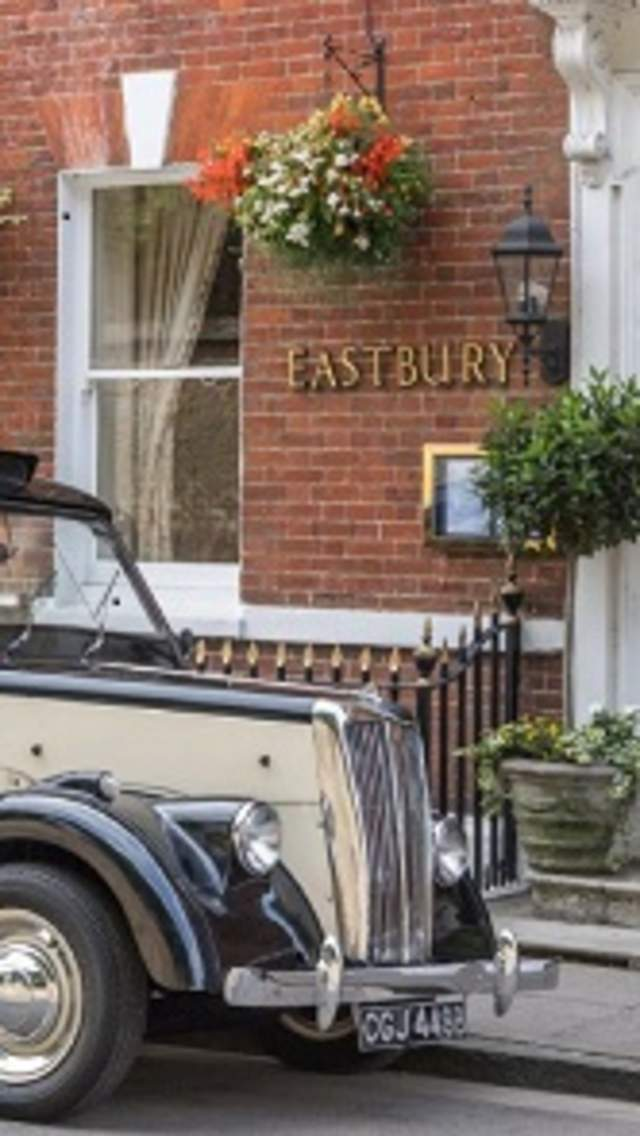Black cab parked outside the front door of the Eastbury Hotel