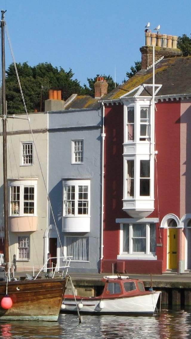 Colourful cottages overlooking Weymouth harbour