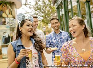 Two couples enjoying the Epcot® Food & Wine Festival