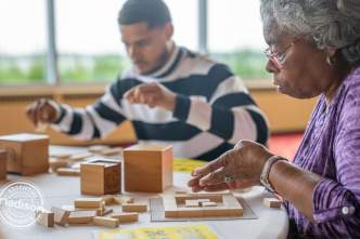 A young man and older woman create a Frank Lloyd Wright inspired craft