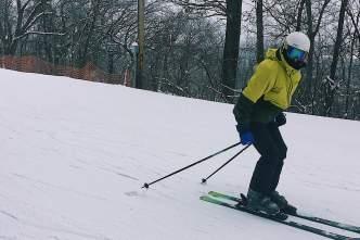 An individual downhill skiing at Tyrol Basin