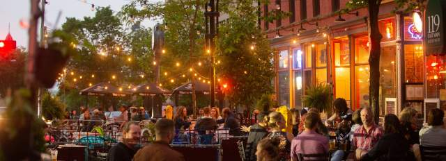 Patrons fill a downtown Madison streatery on a spring evening