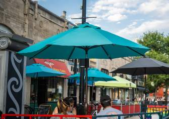 People eat outside at a streatery on State Street