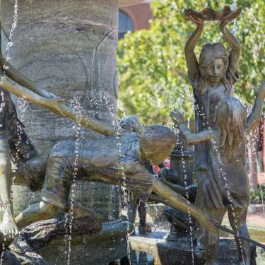 a large fountain with children