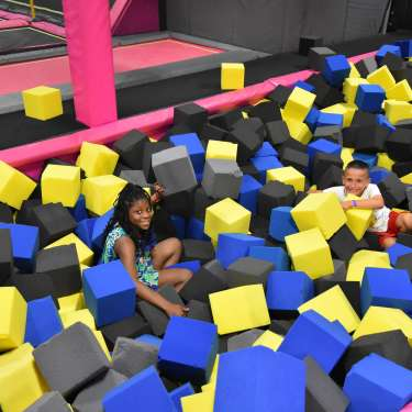 boy and girl playing in large foam blocks
