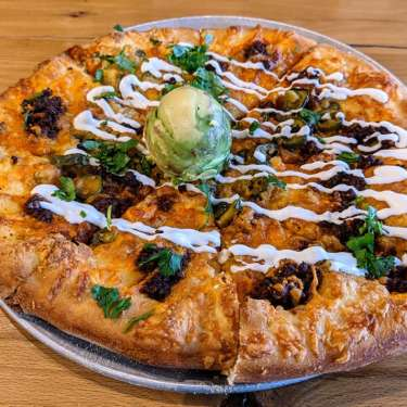 One Bistro Southwest Pizza with avocado and lime sour cream