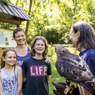 Mother, son & daughter with raptor and handler