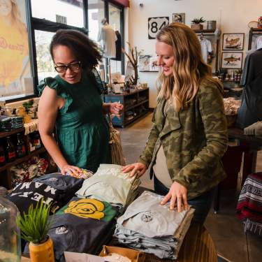 Two women shopping at Tumbleweed TexStyles