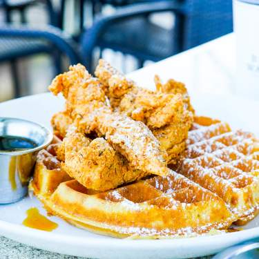 Plate of fried chicken and waffles from Black Walnut Cafe