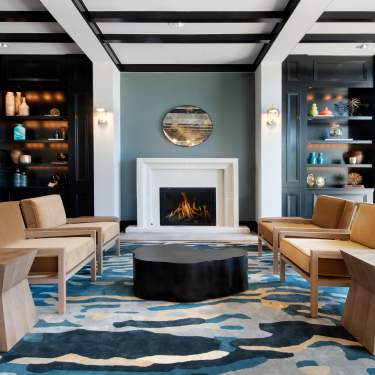 Fireplace and sitting area in The Westin Stonebriar Golf Resort & Spa's lobby