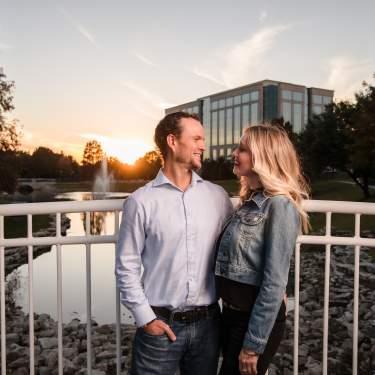 Couple on bridge at sunset at the Texas Sculpture Garden