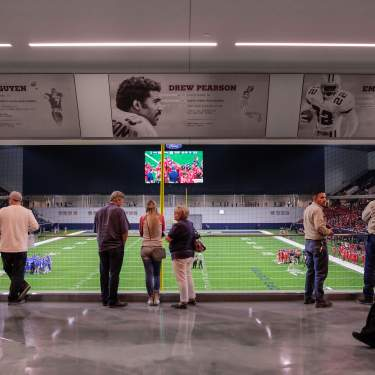 People overlooking field at Ford Center at The Star
