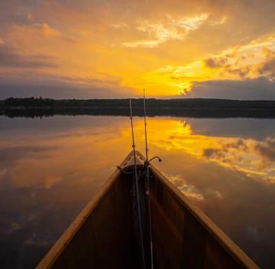 Canoe Fishing at Sunset