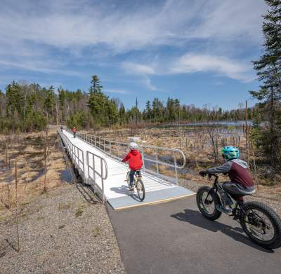 Bikers riding on paved trail