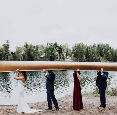 Wedding Party Carries a Canoe