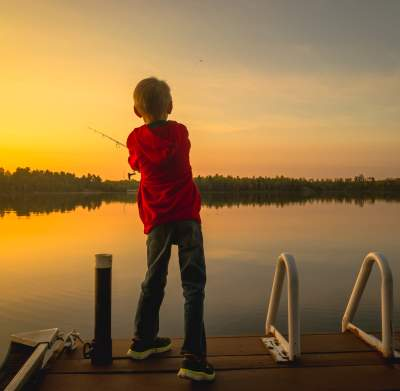 Boy Casting from the Dock