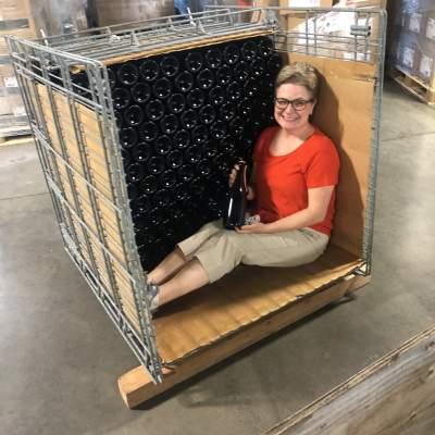 Megan Markel sits smiling in a gyropalette.