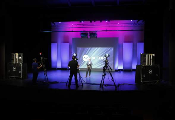 A film crew records a speaker at the Meydenbauer Center's Virtual Event Studio in Bellevue.