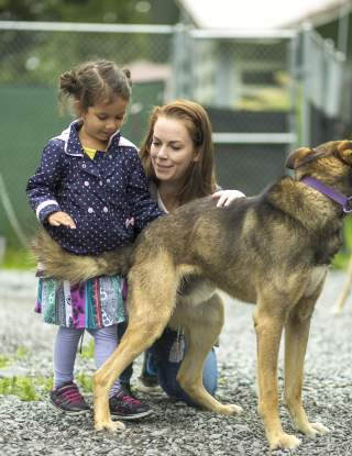 Family at dog kennel