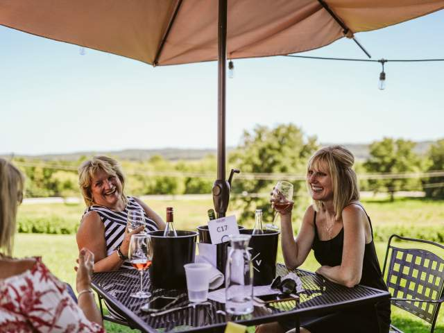 Women eating on terrace of Defiance Ridge Vineyards