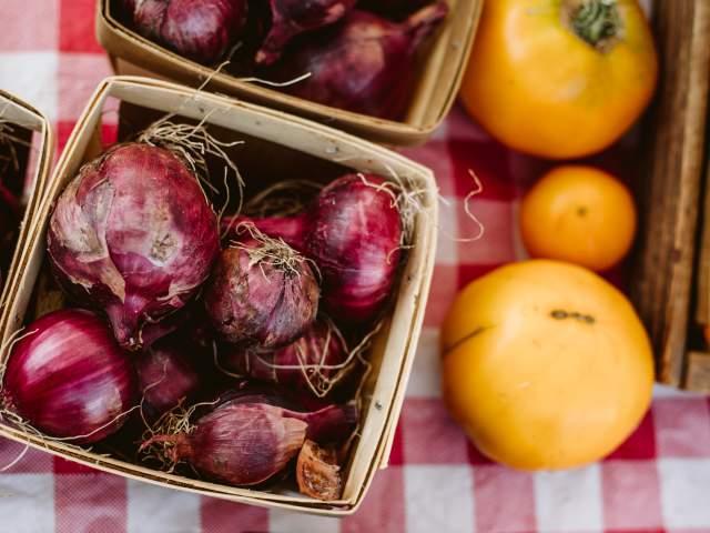 Shallots in basket at farmers market