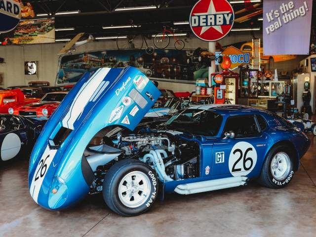 Classic cars in large car garage.