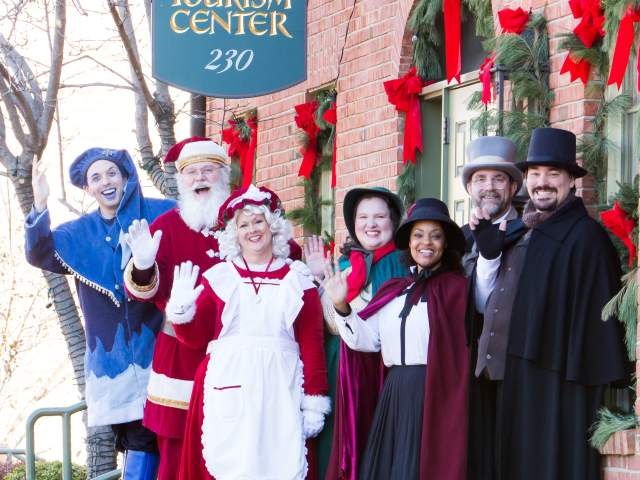 Gathering of Christmas Traditions characters waving outside the St. Charles, MO Tourism Center