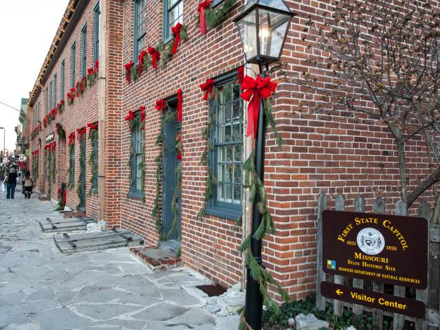 Exterior of St Charles visitor center decorated for Christmas