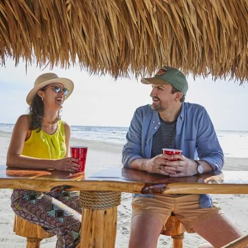 Couple Drinking on Beach