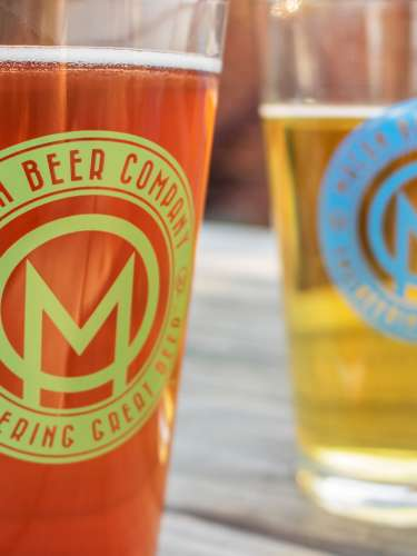 Two pint glasses of local beer from the Macon Beer Company.