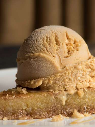 A slice of Cracked Pie topped with ice cream from Dovetail in Macon, GA.