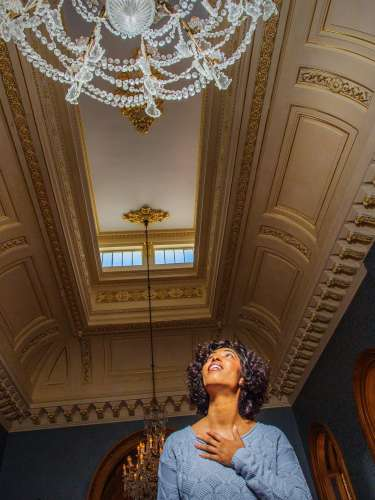 A visitor admires the ornate details on the ceiling at the Hay House in Macon, GA.