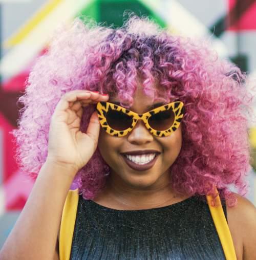 Woman with purple hair & sunglasses