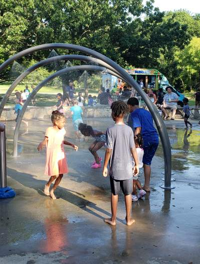 Kids playing in splash pad at Finch Park