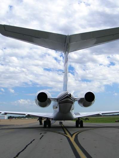 Photo of the tail of a jet at the McKinney National Airport