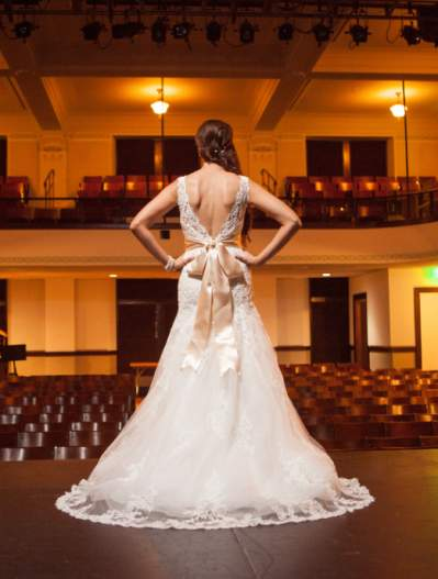 View of the back of a bride on stage at McKinney Performing Arts Center