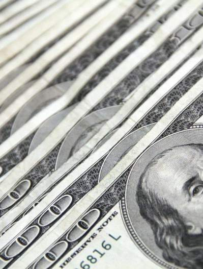 Stock of $100 bills spread out