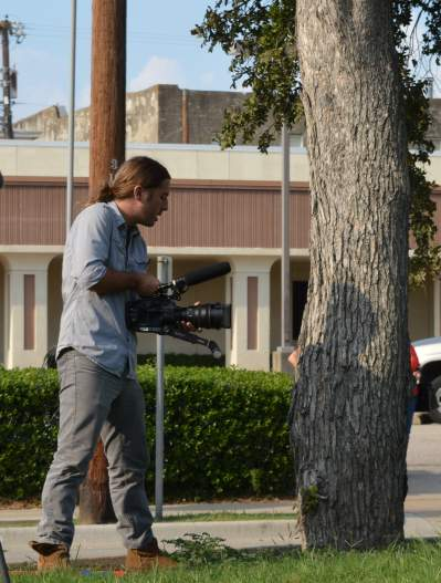 Two-man film crew shooting a movie scene in downtown McKinney