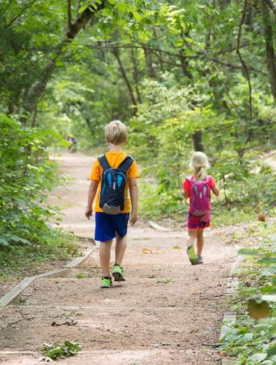 Two children walking on the trails at The Heard Museum