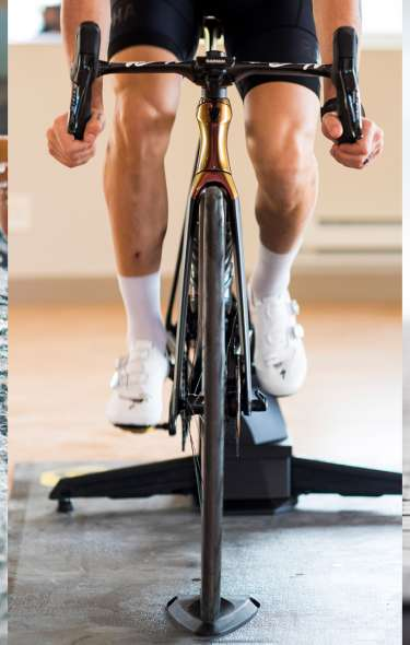 Three images side by side. An indoor swimmer, biker and runner.