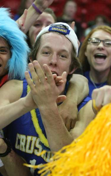 A group of WIAA fans cheering in the stands