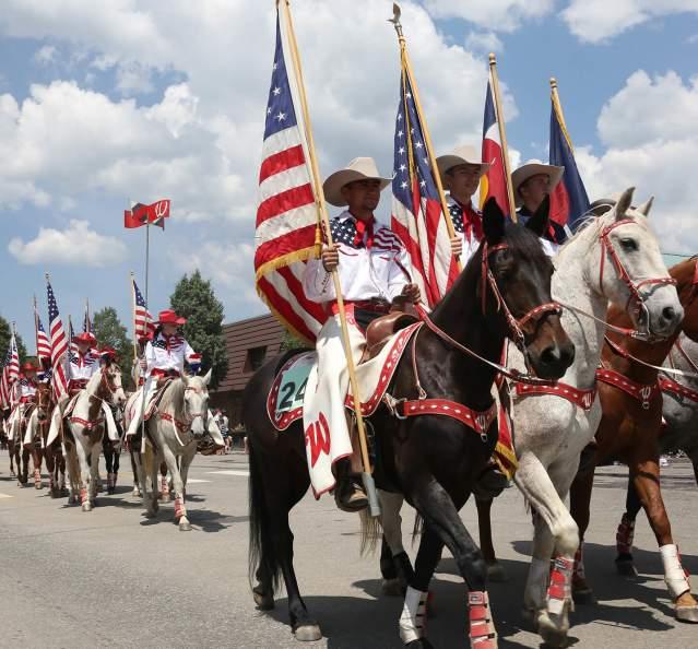 Horses and flags at 4th of July Parade