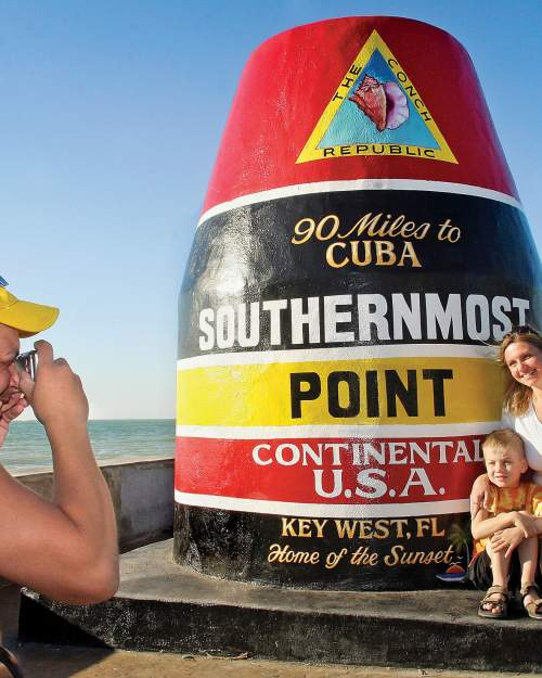 family at Southern Most Point marker
