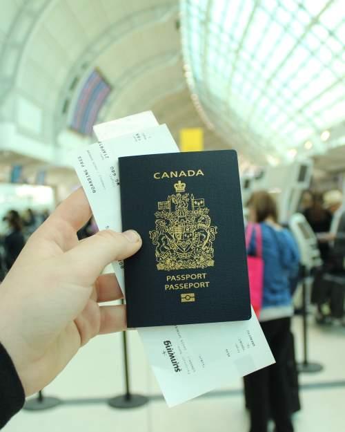 canadian passport in airport hands