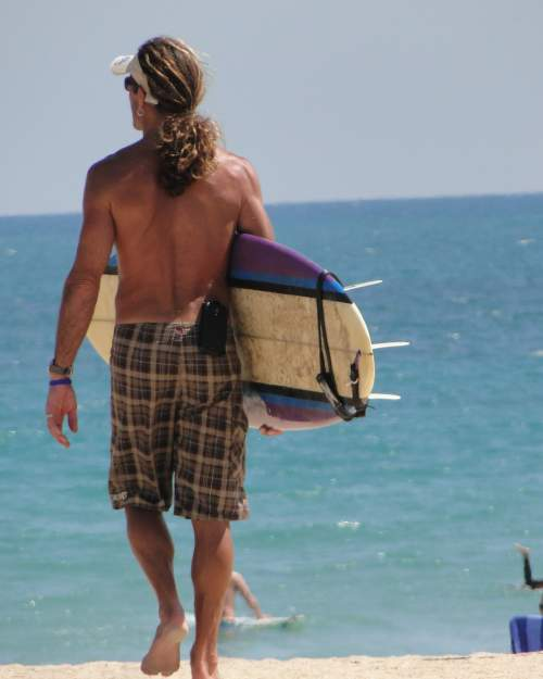 A surfer heads out to make some waves at Fort Pierce Inlet State Park.
