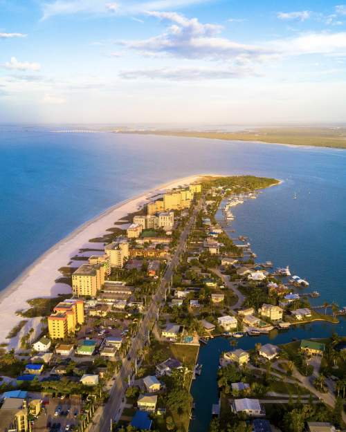 aerial view of fort meyers as it trails off into the ocean