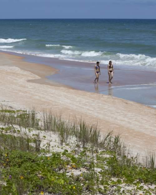ladies walking the beach